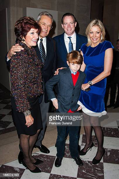Nadja Swarovski poses with her husband Rupert Adams her son Rigby and her mother attend the Swarovski Dinner In Honor of the Bouroullec Brothers at...