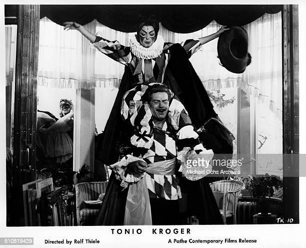 Nadja Tiller in clown costume frolics with Walter Giller in a scene from the movie Tonio Kroeger circa 1964