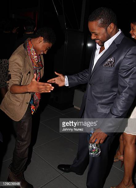 Nadji Jeter and MalcolmJamal Warner attend the Reed Between The Lines VIP screening at Bar Basque on October 10 2011 in New York City