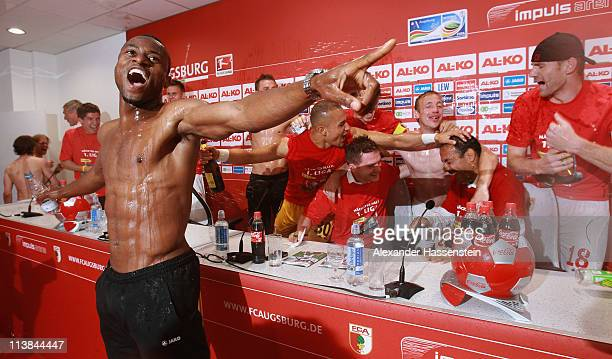 Nado Rafael of Augsburg and his team mates celebrates with her head coach Jos Luhukay during a press conference after the Second Bundesliga match...