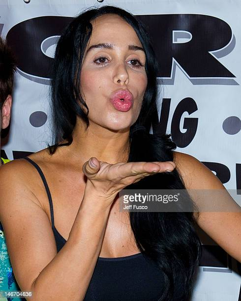Nadya 'Octomom' Suleman blows a kiss at the Celebrity Pillow Fight Press Conference and Weigh In at the Fox And Hound Pub and Grille on June 22 2012...