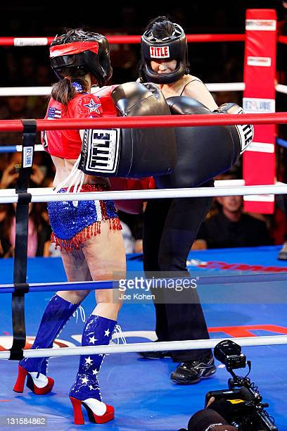 Nadya Octomom Suleman fights Amy Fisher during Celebrity Fight Night At The Avalon on November 5 2011 in Hollywood California