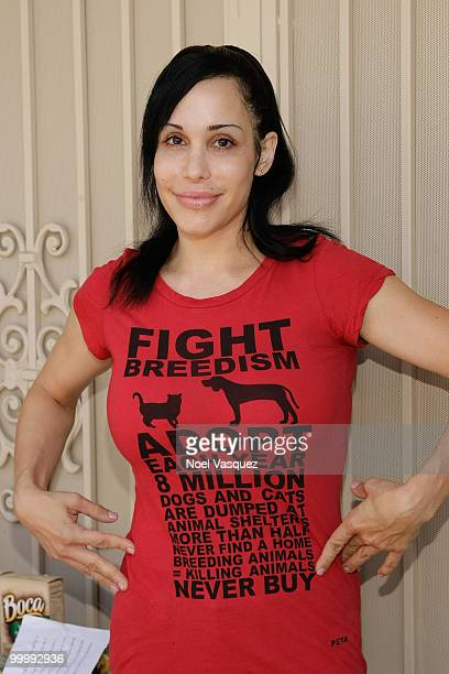 Nadya Octomom Suleman unveils a banner for pet birth control in front of her home on May 19 2010 in La Habra Orange California
