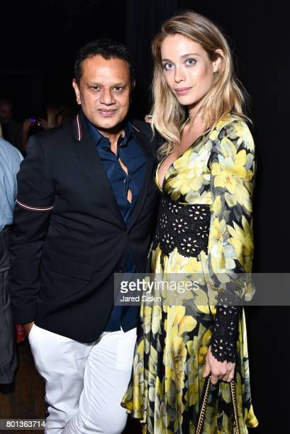 Naeem Khan and Genevieve Barker attend The Dom Perignon Vintage Trinity Launch Party at 17 Irving Place on June 22 2017 in New York City