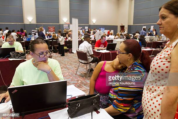 Naemi Lugo and her mother Felicita Lugo file for unemployment with the help of Debra McGinnis on September 3 2014 at the Atlantic City Convention...