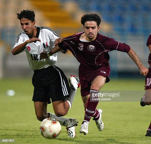 Nafid Mohammad of Qatar's youth team vies with Haidar Sabah of the Iraqi team during a friendly match at Doha's AlIttihad stadium 03 June 2004 AFP...