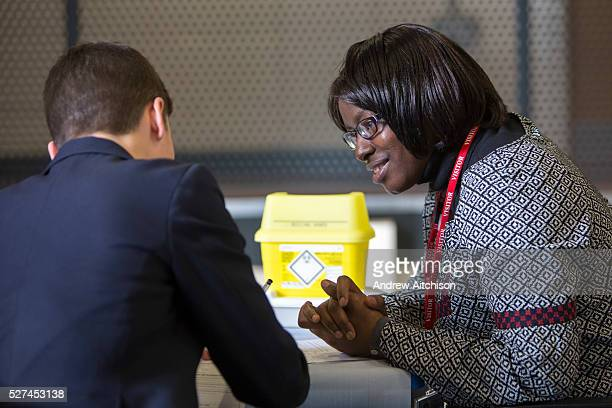 Nafisatu Samuray nurse for London TB Extended Contact Tracing team interviews a teenage boy who has had been identified as having contact with a case...