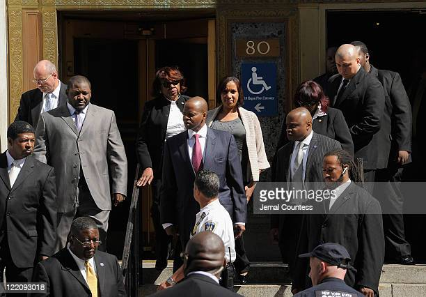 Nafissatou Diallo's attorney Kenneth P Thompson and Nafissatou Diallo depart a meeting with the Manhattan District Attorney on August 22 2011 in New...