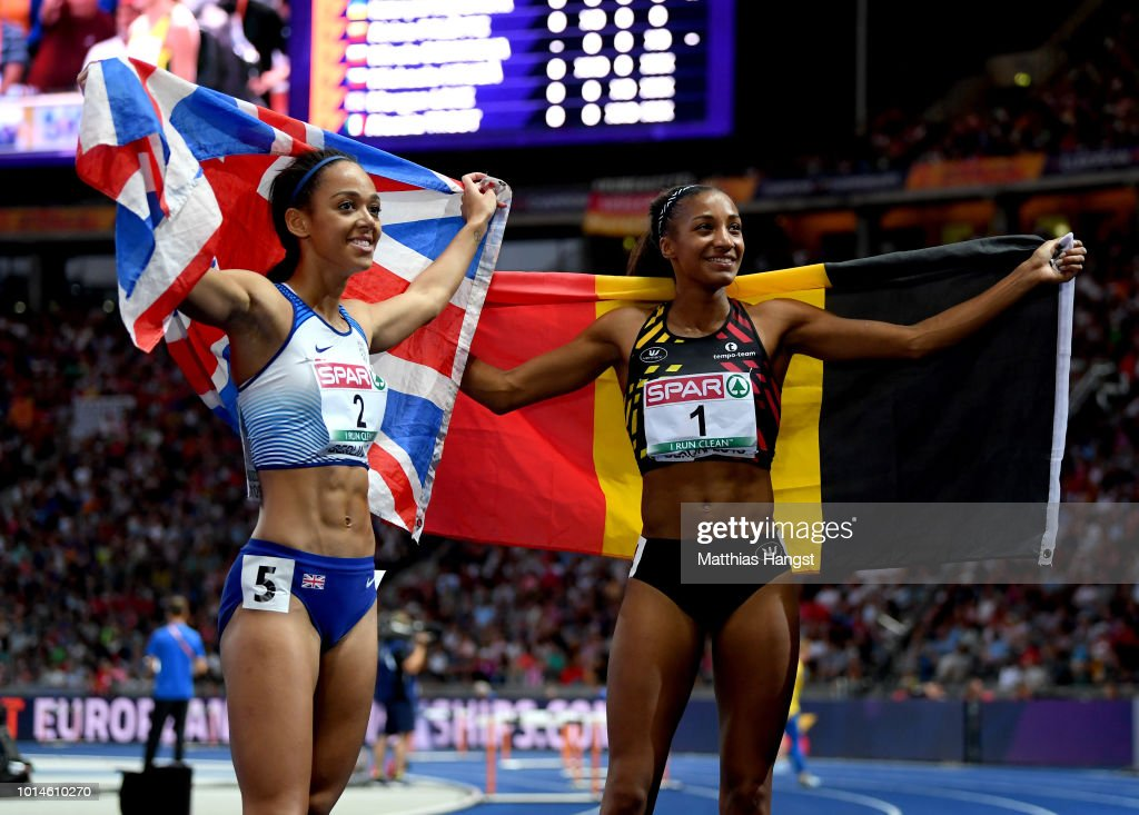Nafissatou Thiam of Belgium and Katarina Johnson-Thompson of Great Britain celebrate after winning Gold and Silver retrospectively in the Women's Heptathlon during day four of the 24th European Athletics Championships at Olympiastadion on August 10, 2018 in Berlin, Germany. This event forms part of the first multi-sport European Championships.