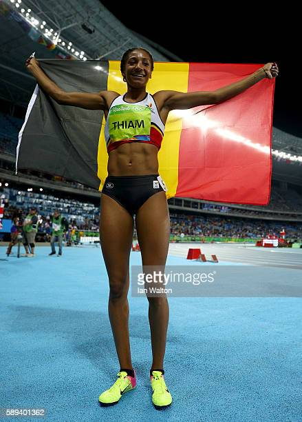 Nafissatou Thiam of Belgium celebrates winning gold in the Women's Heptathlon on Day 8 of the Rio 2016 Olympic Games at the Olympic Stadium on August...