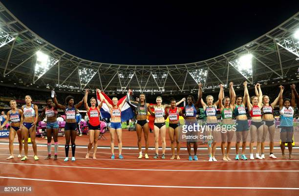 Nafissatou Thiam of Belgium gold Carolin Schafer of Germany silver and Anouk Vetter of the Netherlands bronze celebrate with other Heptathetes after...