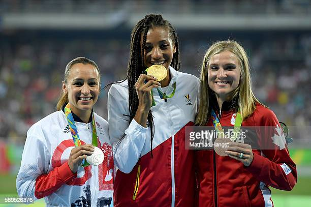 Nafissatou Thiam of Belgium poses with the gold medal Jessica EnnisHill of Great Britain silver medal and Brianne Theisen Eaton of Canada bronze...
