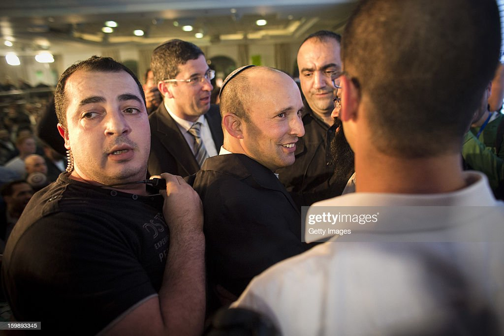 Naftali Bennett (C), leader of the Habayit Hayehudi party (The Jewish Home) greets supporters and activists from his party at a post-election rally on January 22, 2013 in Ramat Gan, Israel. Polls are predicting 12 seats of 120 in the Israeli parliament for the right-wing, religious party led by Naftali Bennett, with Israel seeing the highest turnout of voters since 1999.