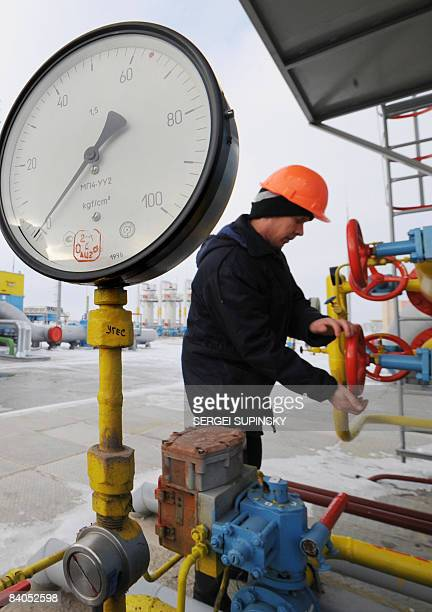 Naftogaz gas company worker adjusts valves after an opening ceremony of the newly built Bobrovnytska gas compressor and holding station in the...