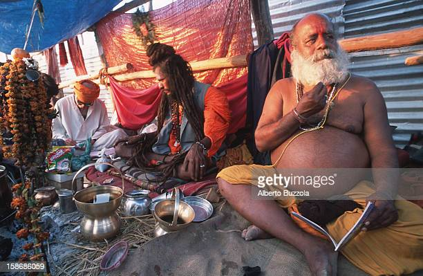 Naga Babas in their tent at the Maha Kumbha Mela festival The Naga Babas are a religious congregation who rarely wear clothes as a sign of...