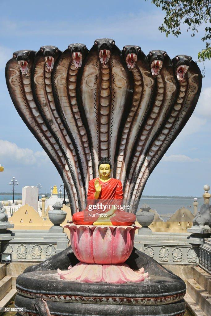 Naga Cobra Sitting Buddha Statue at the Nagadipa Vihara (Nagadeepa Nainativu Buddhist Temple) on Nainativu Island in the Jaffna region of Sri Lanka.