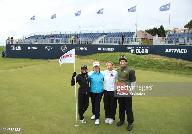 Naga Munchetty Clare Balding Rachel Finnis and Oliver Fisher of England pose for a photograph on the 18th green during the Pro Am prior to the start...