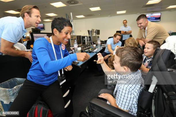 Naga Munchetty representing Action for ATÊmakes a trade at GFI Charity Day on September 11 2017 in London England