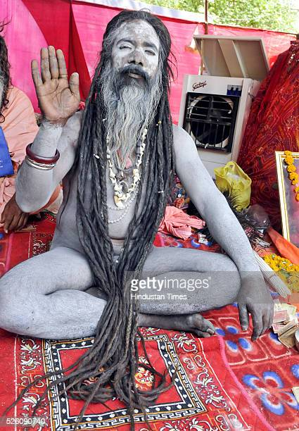Naga Sadhu blessing his devotees during the ongoing Simhasth fair on April 28 2016 in Ujjain India The Ujjain Kumbh is one of the four fairs...