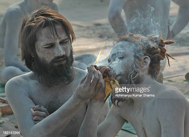 CONTENT] Naga Sadhu during the MahaKumbha 2013 Religious festival world's biggest Human gathering at the confluence of Holy River Ganges Yamun and...