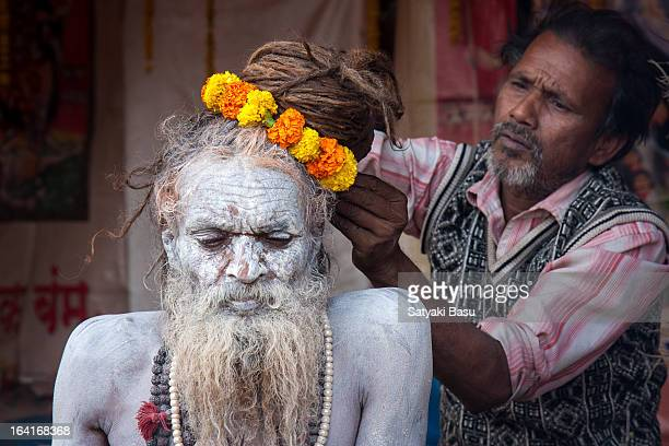 Naga sadhu is being decorated with garlands by his disciple in the Gangasagar transit camp in kolkata