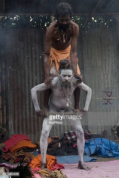 A naga sadhu is busy in performing acrobatic stunts at the camp Babughat Kolkata India on 11 January 2017