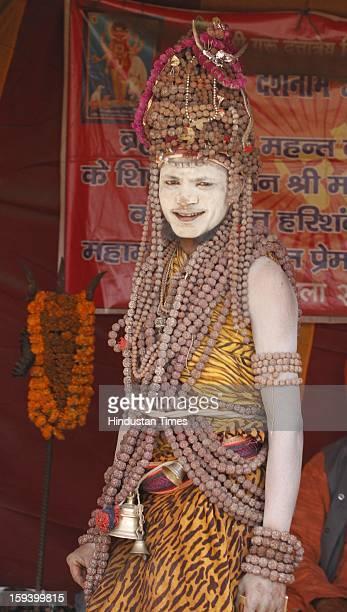 Naga Sadhu of Juna Akhara at banks of the Sangam ahead of Maha Kumbh festival on January 13 2013 in Allahabad India The Kumbh Mela is mass Hindu...
