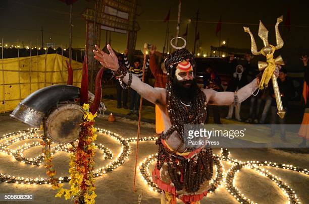 Naga Sadhu offers evening prayers at his tent in the bank of Sangam the confluence of River Ganga Yamuna and Mythological Saraswati during the...