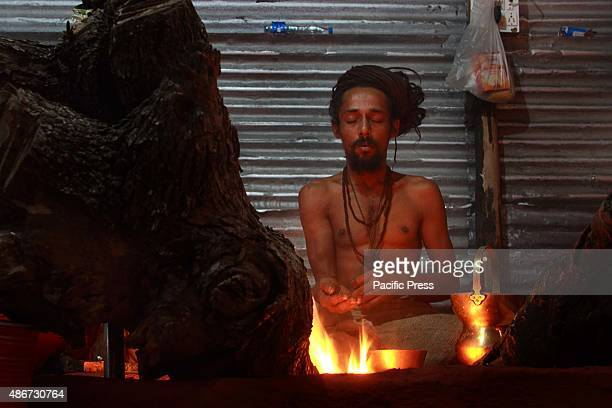 Naga Sadhu or the Naked holy man heating himself up at Trimbak district Nasik to take the first royal bath