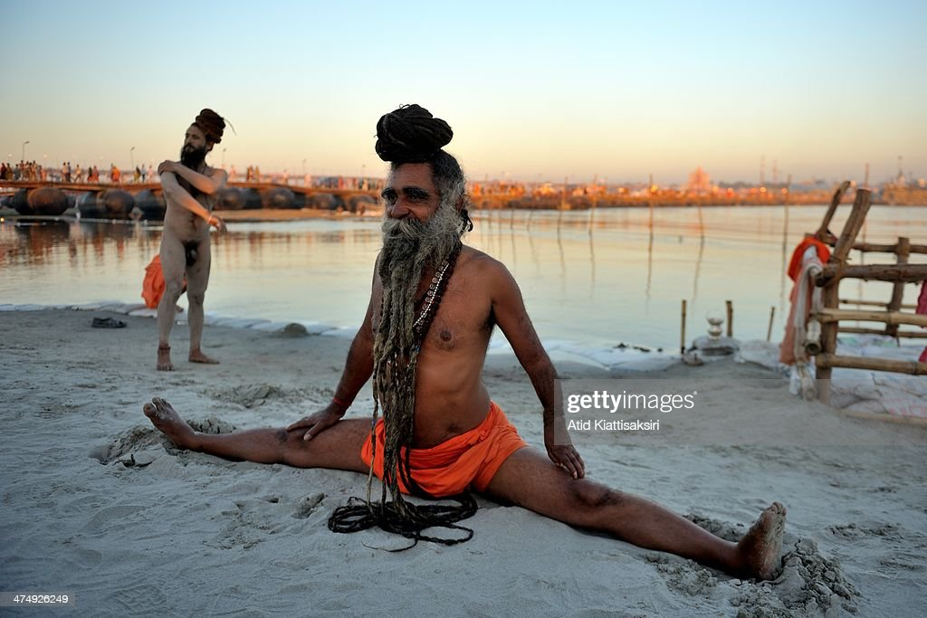 Naga Sadhu Performs Yoga On The Bank Of Ganges River During Maha Kumbh Mela