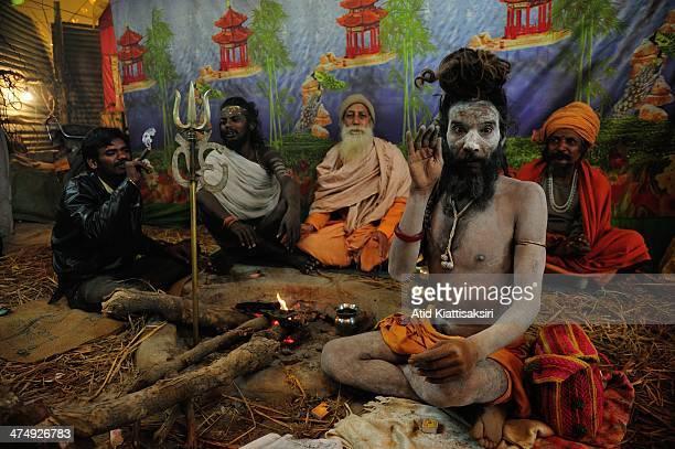 Naga Sadhu poses in his tent at the Sangam, the confluence of Ganges, Yamuna and mythical Saraswati rivers during Maha Kumbh Mela.