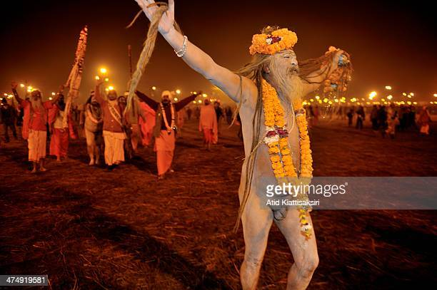 Naga Sadhu shows his long hair as he walks toward the Sangam the confluence of Ganges Yamuna and mythical Saraswati rivers during the Shahi Snan of...