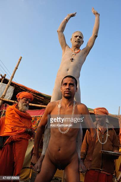 Naga Sadhu shows the release of passion by carrying another Sadhu on a steel bar which is wrapped round by his penis at Sangam the confluence of...