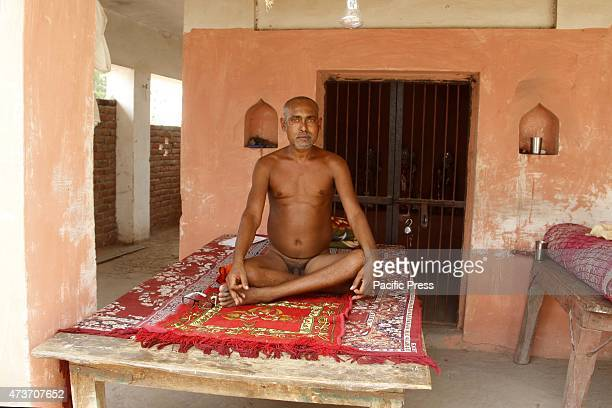 Naga Sadhu sitting at their Ashram on Friday A sadhu is a mystic an ascetic the one who knows all and is liberated from the materialistic world of...