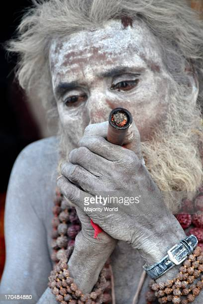 A Naga Sadhu with his chillam at Kumbh Mela the biggest Hindu religious pilgrimage The number of pilgrims this year is expected to exceed around five...