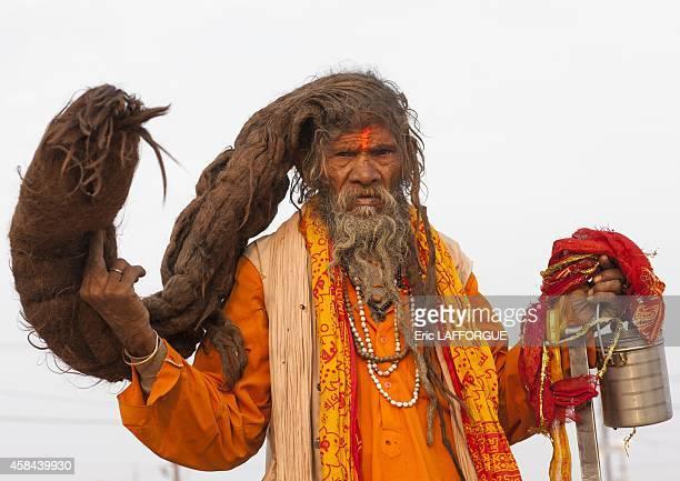 Naga sadhu with very long hair maha kumbh mela on February 12 2013 in Allahabad India