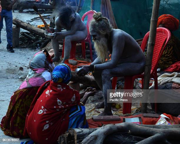 Naga Sadhu/holy man blesses the devotees visiting in the transit camp at Babughat Hindhu holy man and women from all over the country started...