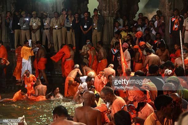 Naga Sadhus also known as the Naked Holy Men take part in the first 'Sahi bath or royal bath at Trimbak district Nasik