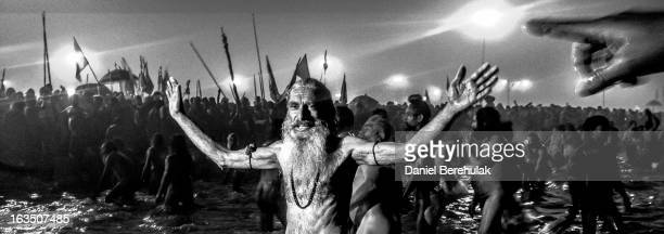 Naga sadhus bathe in the waters of Sangam during the auspicious bathing day of Makar Sankranti of the Maha Kumbh Mela on January 14 2013 in Allahabad...