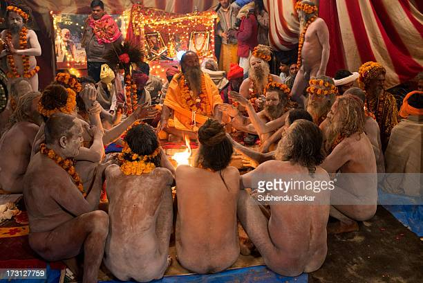 CONTENT] Naga sadhus gather around a holy fire in an early morning on the occasion of Maha Kumbh Mela at Allahabad Uttar Pradesh India