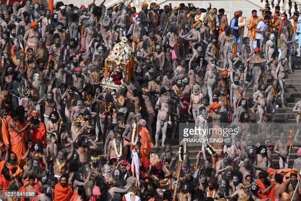 Naga Sadhus gather before taking holy dip in the waters of the River Ganges on the Shahi snan on the occasion of Maha Shivratri festival during the...