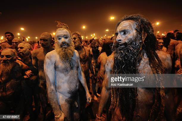 Naga Sadhus gather for a procession to bathe on the banks of Sangam, the confluence of the holy rivers Ganges, Yamuna and the mythical Saraswati for...