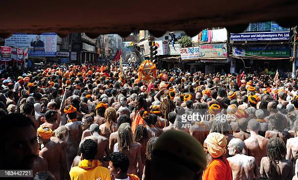 Naga sadhus Hindu holy men take out a religious procession to offer holy water from the Ganga river at the Kashi Vishwanath Temple in Varanasi on...