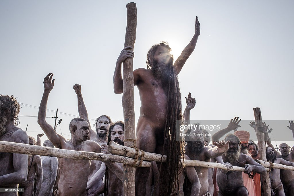 Naga Sadhus, naked Hindu holy men, return in procession after having bathed on the banks of Sangam, the confluence of the holy rivers Ganges, Yamuna and the mythical Saraswati, on the auspicious bathing day of Mauni Amavasya during the Maha Kumbh Mela on February 10, 2013 in Allahabad, India. The Maha Kumbh Mela, believed to be the largest religious gathering on earth, is held every 12 years on the banks of Sangam, the confluence of the holy rivers Ganga, Yamuna and the mythical Saraswati. The Kumbh Mela alternates between the cities of Nasik, Allahabad, Ujjain and Haridwar every three years. The Maha Kumbh Mela celebrated at the holy site of Sangam in Allahabad, is the largest and holiest, celebrated over 55 days, and is expected to attract over 100 million people.