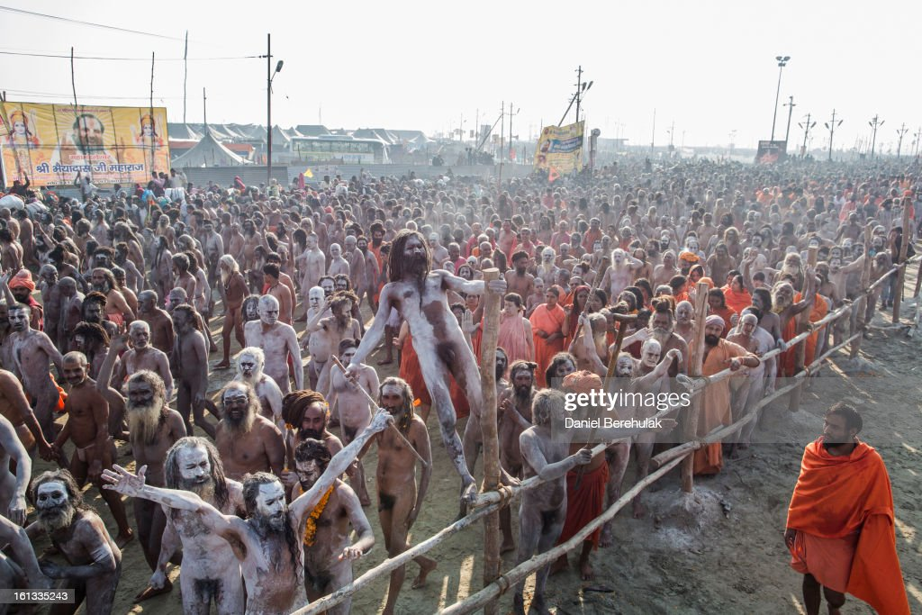 Naga Sadhus, naked Hindu holy men, walk in procession to bathe on the banks of Sangam, the confluence of the holy rivers Ganges, Yamuna and the mythical Saraswati, on the auspicious bathing day of Mauni Amavasya during the Maha Kumbh Mela on February 10, 2013 in Allahabad, India. The Maha Kumbh Mela, believed to be the largest religious gathering on earth, is held every 12 years on the banks of Sangam, the confluence of the holy rivers Ganga, Yamuna and the mythical Saraswati. The Kumbh Mela alternates between the cities of Nasik, Allahabad, Ujjain and Haridwar every three years. The Maha Kumbh Mela celebrated at the holy site of Sangam in Allahabad, is the largest and holiest, celebrated over 55 days, and is expected to attract over 100 million people.