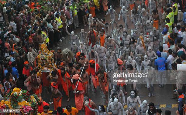 Naga sadhus of akharas and others on the way to take a holy dip in Shipra River on the third and the last 'shahi snan' of monthlong Simhastha Kumbh...