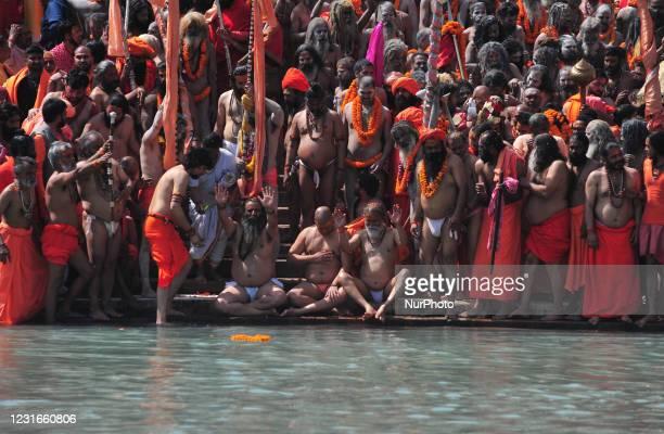 Naga Sadhus or holy man of Niranjani Akhara prepares to take a holy dip in Ganges River on the occasion of first royal bath of Shivratri festival...