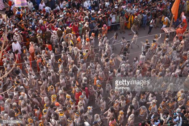 Naga Sadhus or holy men of Juna Akhara move towards ganges River to take a holy dip on the occasion of first royal bath of Shivratri festival during...