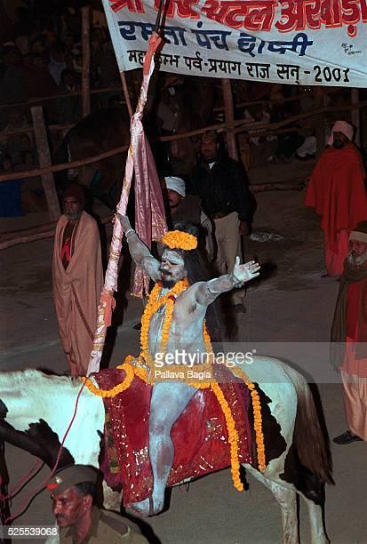 Naga Sadhus or naked holy man on horse back as part of royal procession