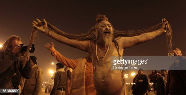 Naga sadhus' perform rituals on the banks of the Ganga River during the MahaKumbh festival in Allahabad.